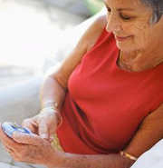 Baby boomer shopping on mobile phone