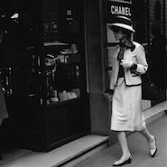 Coco Chanel walking past 31 Rue Cambon