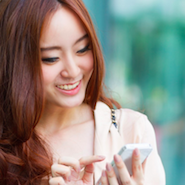 Chinese consumer uses mobile device