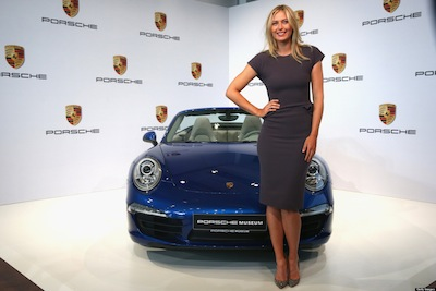 STUTTGART, GERMANY - APRIL 22: Tennis player Maria Sharapova poses for the media next to a Porsche 911 Carrera 4 Cabriolet as she is unveiled as car manufacturer Porsche's new brand ambassador at the Porsche Museum on April 22, 2013 in Stuttgart, Germany. (Photo by Alexander Hassenstein/Bongarts/Getty Images)