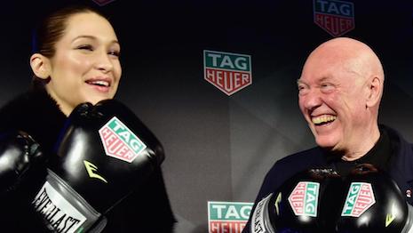 Bella Hadid with Tag Heuer CEO Jean-Claude Biver